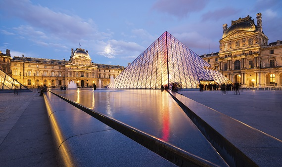 View of the Louvre Museum and the Pyramid at twilight.